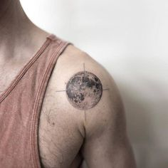Fine line moon tattoo on the left shoulder. Tattoo artist:...