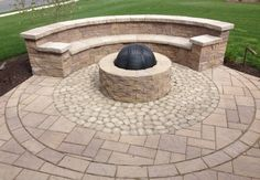 Firepit with seating wall and interesting paver patterns.