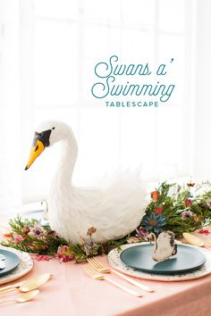 Swans a swimming tablescape with printable name tags and flowers and  DIY swan