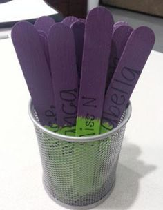 Two-colored sticks, with student names. Flip over once each child has been picked. Keeps the class fair :-)