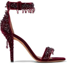 Givenchy's sandals have been masterfully crafted in Italy from one of our favorite fabrics of the season - velvet. Set on a subtly curved heel, this burgundy pair is decorated with elegantly suspended crystals that move as you walk. Wear them with everything from skinny jeans to cocktail dresses.
