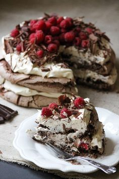 Chocolate meringue, layered with vanilla bean whipped cream, topped with raspberries and chocolate shavings.