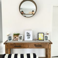Our beautiful entry way ft the Kmart mirror! I love having my children's art on display and some family photos