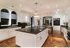My dream kitchen has white cabinets and a huge island, like this...