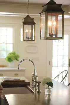 "Brass Lanterns in White Kitchen. Jenny Steffens Hobick: Our ""Classic"" White Kitchen Design | Marble Countertops, Wood Island Top, Brass Pulls & Lanterns"