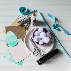 Materials - Easter Bunny Photo Prop - Southernliving. -2 plain white paper plates-Stapler-1 large Pixie Stick-Large paint samples in Easter colors-Brown or tan hemp cord-White cotton balls-5 different kinds of ribbon (½ yard each)