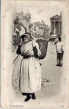 Picture of a fish wife walking down Market Jew Street, Penzance. - Collections - Penlee House Gallery and Museum Penzance Cornwall UK