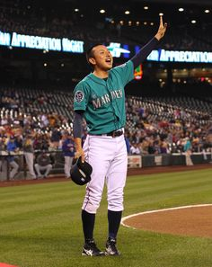 Munenori Kawasaki #61 of the Seattle Mariners acknowledges the crowd after receiving the MLB Heart and Hustle award prior to the game against the Texas Rangers at Safeco Field on September 21, 2012 in Seattle, Washington. (September 20, 2012 - Source: Otto Greule Jr/Getty Images North America)