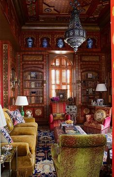 Love the chandelier and bookcases.Floor to ceiling pattern.