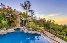 Three acres and a gated, 1/4 mile driveway offer ultimate privacy for this Henry Hester- designed home in La Jolla