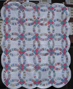 Double Wedding Ring Quilt at www.antiquequilts.com/catalog14.htm#17503