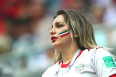 A female fan of Iran looks on during the 2018 FIFA World Cup Russia group B match between Morocco and Iran at Saint Petersburg Stadium on June 2018 in Saint Petersburg, Russia. Get premium, high resolution news photos at Getty Images Iran Football, Hot Football Fans, Football Girls, Soccer Fans, Football Soccer, Iran National Team, Beautiful Iranian Women, Iranian Beauty, Persian Girls