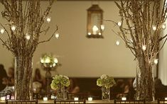 Branch centerpieces, tea lights, and small flower bouquets...almost exactly the look I want.