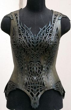 http://romancero.nethouse.ru/products Amazing Corsets in pierced tooled leather.