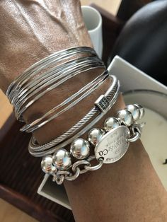 A silver stack Silver Bracelets, Silver Jewelry, Bangles, Jewelry Accessories, Fashion Accessories, Stacked Necklaces, Mode Outfits, Bracelet Designs, Jewelery