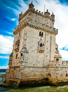 Lisbon, Portugal. Marvel at the Portuguese Manueline-style architecture of the Belém Tower, a 100-foot watchtower decorated with symbols of royal power.