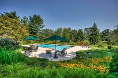 Surrounded by perennial gardens and flowering trees, this Gunite pool in the Bernardsville Mountain section of Bernardsville commands attention with an understated elegance characteristic of the home at 67-1 Ballantine Road.