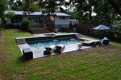 Modern Swimming Pool with glass tile by Hilltop Pools.