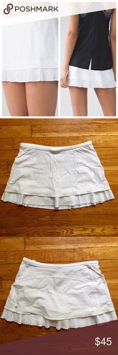 """Lululemon // Running Skirt with built in shirts NWT! White lululemon athletica running skirt with short liner. Sweat-wicking, lightweight fabric with four-way stretch. Medium rise, 3.25"""" inseam. Multiple pockets, internal cord exit for headphones. Hugged sensation. Reflective logo on back hem. 🚫trades🚫 smoke free home lululemon athletica Shorts Skorts"""