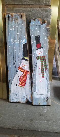 Snowmen on driftwood