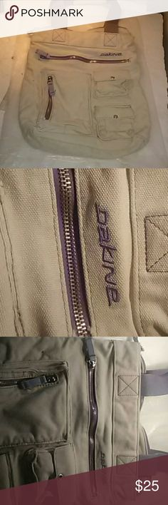 DAKINE CARRYING TOTE BAG This bag is really cool made of a strong material.  The material they make high strength army pants out of.  It has really small button pockets and zip cross pockets.  The inside is soft with a great light purple tint. Dakine Bags Totes