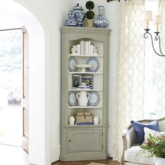 With our Marlene Corner Display Cabinets, you can enjoy built-in looks and storage without the custom price. Rich stepped molding and a curved cornice create a stage to show off your favorite platters and glassware.