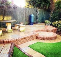 Photo of a patio, small feature wall and artificial grass