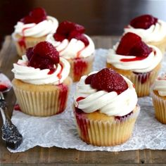 Roasted strawberry cupcakes topped with a light & fluffy mascarpone frosting - summer berry bliss!