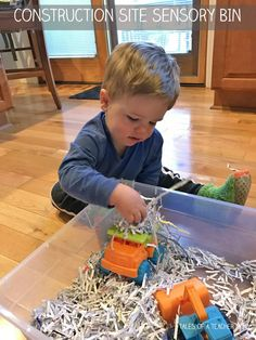Construction Site Sensory Bin - fun toddler activity with cars and shredded paper