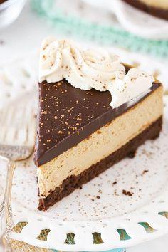 Kahlua Coffee Brownie Cheesecake - a dense brownie bottom, kahlua coffee cheesecake, kahlua chocolate ganache and kahlua whipped cream! Such a rich, creamy and delicious cheesecake!