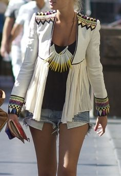 Embellished cream blazer and chunky statement necklace over a simple black tee and cutoff denim shorts - very rock and roll!  Love it!