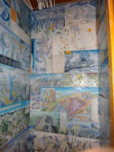 Unique Closet! In the cottage we rented, I found a closet plastered with ski maps from around the world