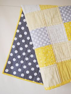 Gray and Yellow Quilt! love the polka dot backing and the way the blanket is quilted - could be done quickly and with a normal sewing machine!