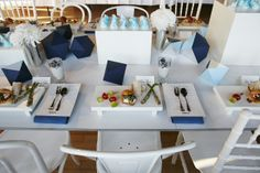 Table settings for recent media event featuring paper jewels, flowers and meringues #blue #jewels #meringues #mimco