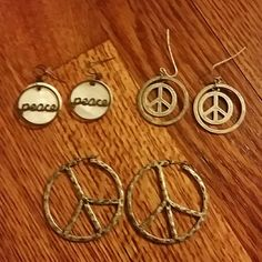 Set of 3 peace earrings Three sets of peace earrings. All are dangling earrings in various sizes. Super cute staple pieces to add to your boho jewlery collection. All barely worn Jewelry Earrings