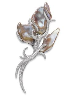 Freshwater Baroque Brooch  One-of-a-kind brooch featuring Freshwater baroque pearls resembling petals, with 5.23cts of diamonds, set in 18k white gold. Mikimoto