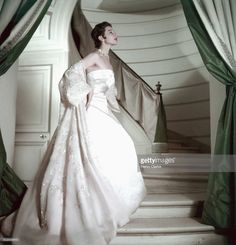 Model on stairs wearing pink strapless gown and organdy coat from Dior. Strapless Gown, Classic Style, Classic Fashion, Christian Dior, Dress Skirt, Gowns, Couture, Elegant, Wedding Dresses