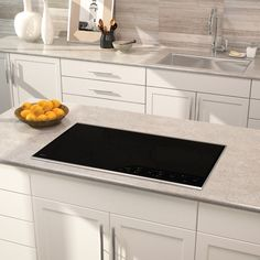 Wolf CI365TS 36 Inch Induction Cooktop with 5 Cooking Zones, 5 Bridge Zone Options, Boost Mode, Pan Sensing, Melt Setting, Independent Timer, Indicators and Control Panel Lock: Transitional, Stainless Steel Trim