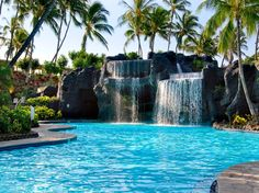 """You can take mahogany canal boats or a tram around the Hilton Waikoloa Village on the Big Island's Kohala Coast, and you might need to: The property stretches over 62 oceanfront acres, and includes an ocean-fed lagoon, three pools with waterfalls, two championship golf courses, 20,000 square feet of shops, and eight restaurants. Adults will love the Kohala Spa, which offers locally inspired treatments like a """"volcanic body ritual"""" using volcanic pumice stone. The resort has three…"""