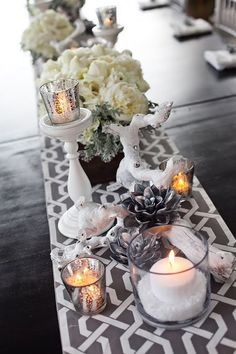 Grey, white & cream wedding centerpieces using wood, candles & fake snow.