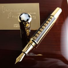 "Barrel enriched by wooden inlays and gold-lettered plates displaying ""Gutenberg"". Gold nib with an ancient ""G"" referring to the eponym Gutenberg. Montblanc logo in Mother of Pearl. Piston Fountain Pen based on the size of a FP Mont Blanc Fountain Pen, Fountain Pen Ink, Stylo Art, Expensive Pens, Johannes Gutenberg, Luxury Pens, Best Pens, Dip Pen, Writing Pens"