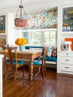 close to the color combo blue white and orange kitchen but especially like the use of framing a window with shelving and using as bench seating