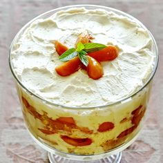 Peaches and Cream Trifle - our peach desserts continue with this luscious trifle dessert. A little peach or apricot brandy soaked into the cake will definitely take this recipe up a notch.