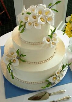 Now my mom has decided she wants me to make the anniversary cake, so I'm looking for ideas. I like the calla lilies. Informations About Now my mom has decided she wants me to make the anniversary cake Elegant Wedding Cakes, Cool Wedding Cakes, Elegant Cakes, Beautiful Wedding Cakes, Gorgeous Cakes, Wedding Cake Designs, Pretty Cakes, Amazing Cakes, Wedding Cupcakes