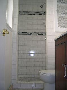 Subway tile shower - I like the decorative bands.