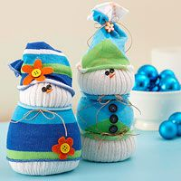 Sock Snowmen   They're made with household materials, like knee-high tube socks, decorative ankle socks, and rice for stuffing. Buttons and twine add cute accents.