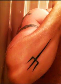 Trident forearm tattoo