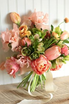 Spring blooms in peach and green :: tulips, iris, ranunculus, hellebore
