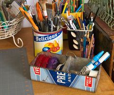 Old cans and tins used for pens and pencils.