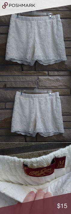 White cream lace elastic waist shorts Beautiful cream white lace shorts with elastic waist. By one love. Size medium. New and never worn. one love Shorts